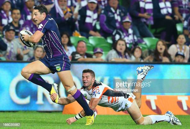 Billy Slater of the Storm gets tackled by James Tedesco of the Tigers during the round 5 NRL match between the Melbourne Storm and the Wests Tigers...