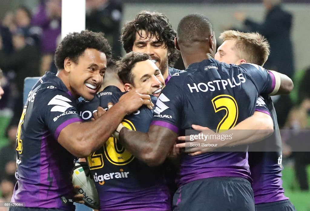 Billy Slater of the Storm is congratulated by his teammates after scoring a try during the round 13 NRL match between the Melbourne Storm and the Newcastle Knights at AAMI Park on June 2, 2017 in Melbourne, Australia.
