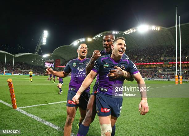 Billy Slater of the Storm is congratulated by his teammates after scoring a try during the NRL Preliminary Final match between the Melbourne Storm...
