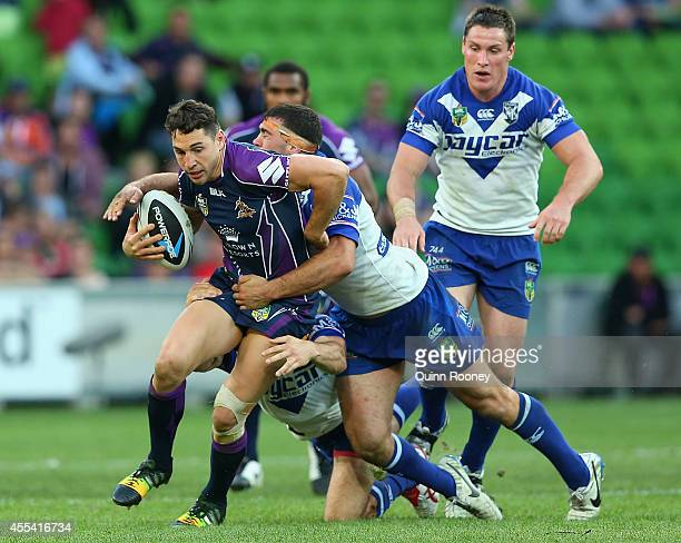 Billy Slater of the Storm is tackled by Dale Finucane of the Bulldogs during the NRL 2nd Elimination Final match between the Melbourne Storm and the...