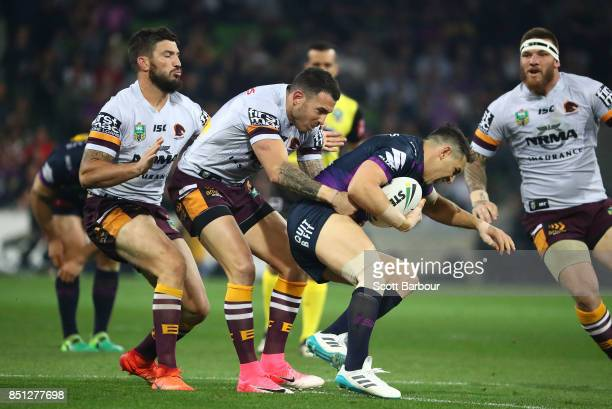 Billy Slater of the Storm is tackled by Darius Boyd of the Broncos during the NRL Preliminary Final match between the Melbourne Storm and the...