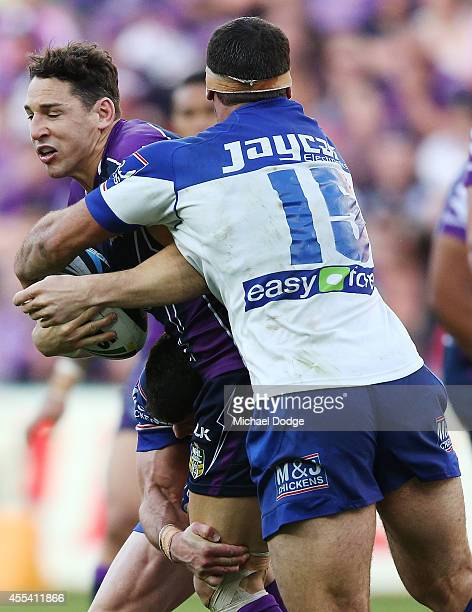 Billy Slater of the Storm is tackled by Dean Finucane of the Bulldogs during the NRL 2nd Elimination Final match between the Melbourne Storm and the...