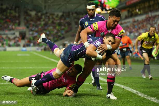 Billy Slater of the Storm is tackled by Elijah Taylor of the Panthers during the round two NRL match between the Melbourne Storm and the Penrith...