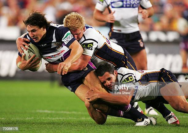 Billy Slater of the Storm is tackled by the Broncos defence during the NRL Grand Final match between the Brisbane Broncos and the Melbourne Storm at...