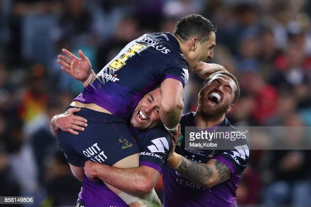 Billy Slater of the Storm is tackled celebrates scorting a try during the 2017 NRL Grand Final match between the Melbourne Storm and the North...