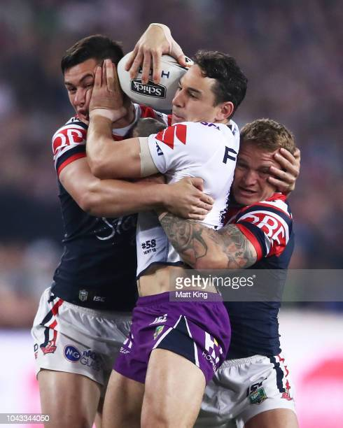 Billy Slater of the Storm is tackled during the 2018 NRL Grand Final match between the Melbourne Storm and the Sydney Roosters at ANZ Stadium on...