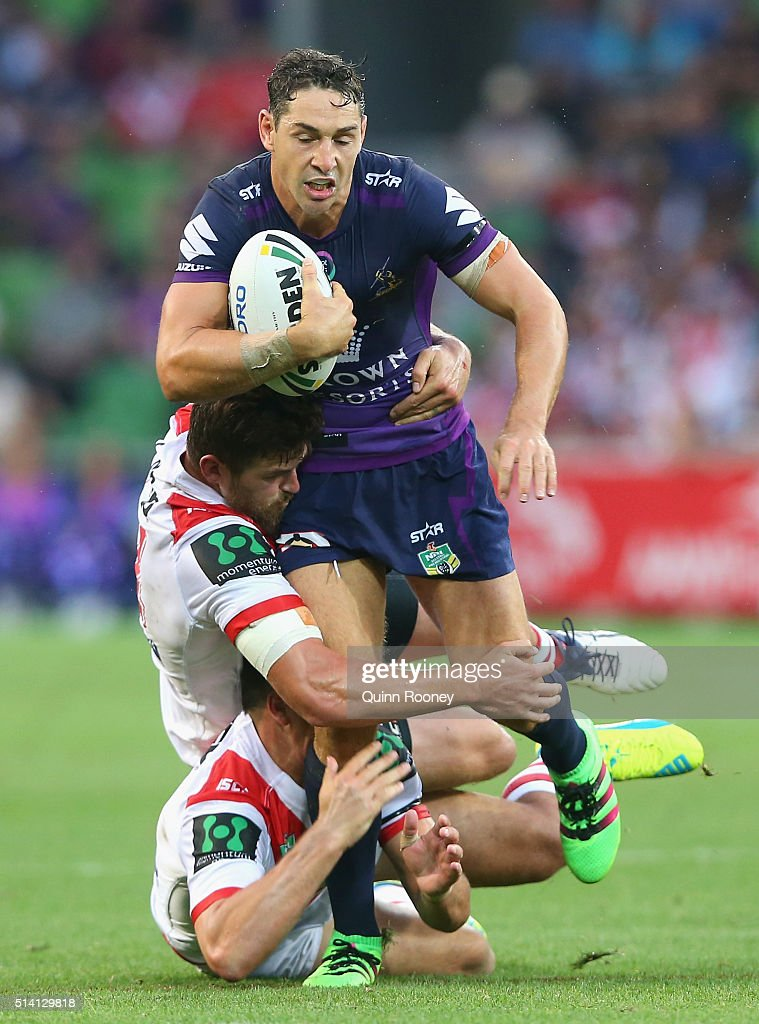 Billy Slater of the Storm is tackled during the round one NRL match between the Melbourne Storm and the St George Illawarra Dragons at AAMI Park on March 7, 2016 in Melbourne, Australia.