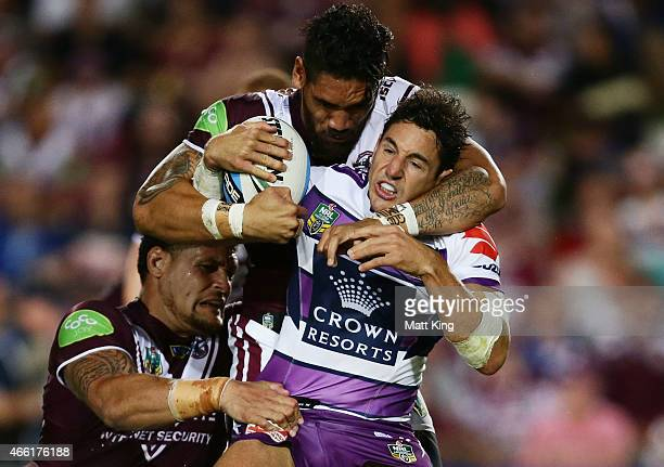 Billy Slater of the Storm is tackled during the round two NRL match between the Manly Warringah Sea Eagles and the Melbourne Storm at Brookvale Oval...