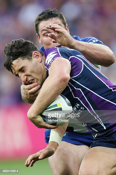 Billy Slater of the Storm is tackled high during the NRL 2nd Elimination Final match between the Melbourne Storm and the Canterbury Bankstown...