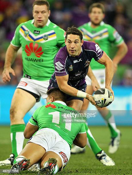 Billy Slater of the Storm looks to offload the ball during the round 19 NRL match between the Melbourne Storm and the Canberra Raiders at AAMI Park...