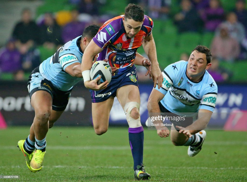Billy Slater of the Storm makes a break during the round 23 NRL match between the Melbourne Storm and the Cronulla Sharks at AAMI Park on August 16, 2014 in Melbourne, Australia.