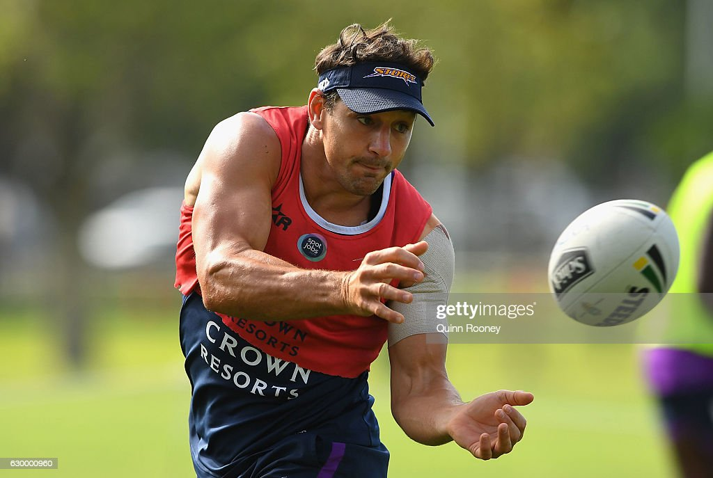 Billy Slater of the Storm passes the ball during a Melbourne Storm NRL training session at Gosch's Paddock on December 16, 2016 in Melbourne, Australia.