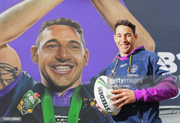 Billy Slater of the Storm speaks to the media infront of graffitti mural of himself at Richmond Station during a Melbourne Storm NRL media...