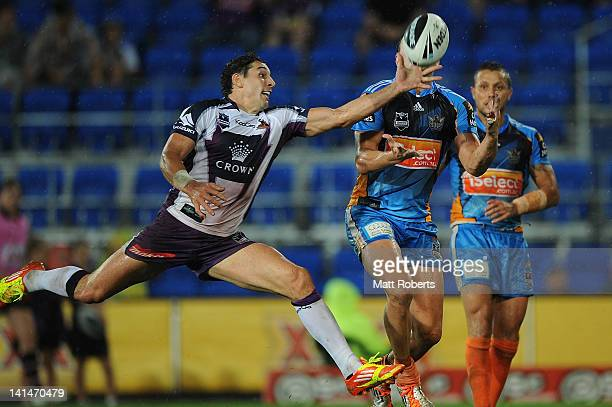 Billy Slater of the Storm reaches for the ball during the round three NRL match between the Gold Coast Titans and the Melbourne Storm at Skilled Park...