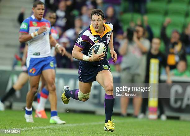 Billy Slater of the Storm runs in to score the match winning try during the round 14 NRL match between the Melbourne Storm and the Newcastle Knights...