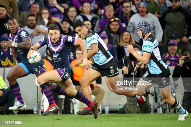 Billy Slater of the Storm runs the ball during the NRL Preliminary Final match between the Melbourne Storm and the Cronulla Sharks at AAMI Park on...