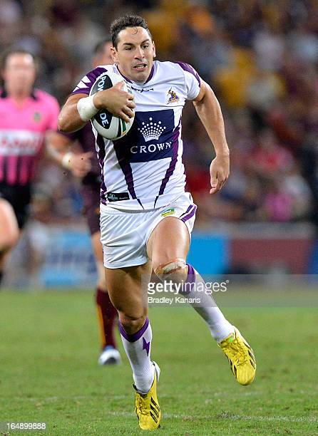Billy Slater of the Storm runs with the ball after breaking free from the defence during the round four NRL match between the Brisbane Broncos and...