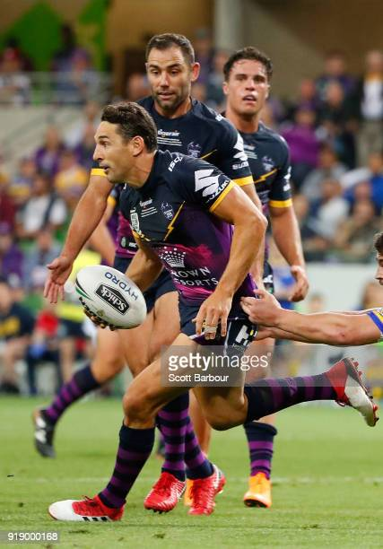 Billy Slater of the Storm runs with the ball as Cameron Smith and Brodie Croft look on during the World Club Challenge match between the Melbourne...
