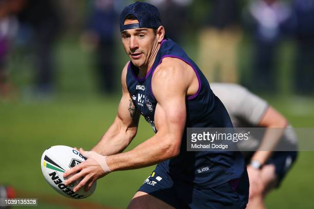Billy Slater of the Storm runs with the ball during a Melbourne Storm NRL training session at Gosch's Paddock on September 24 2018 in Melbourne...
