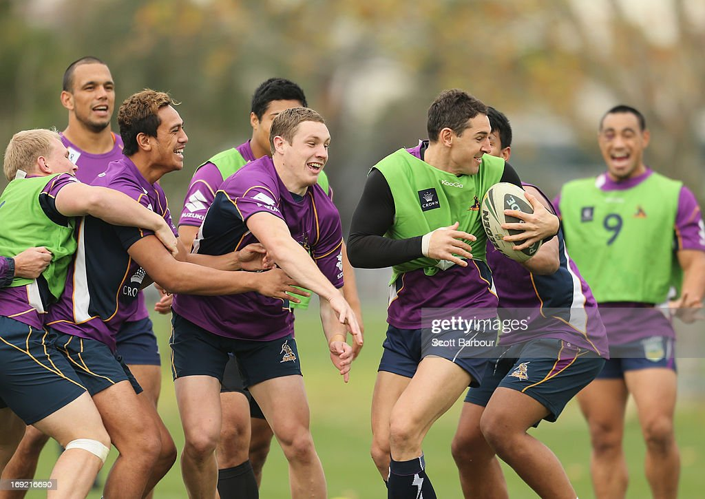 Billy Slater of the Storm runs with the ball during a Melbourne Storm NRL training session at Gosch's Paddock on May 22, 2013 in Melbourne, Australia.