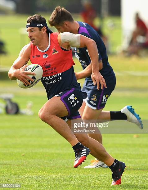 Billy Slater of the Storm runs with the ball during a Melbourne Storm NRL training session at Gosch's Paddock on December 16 2016 in Melbourne...