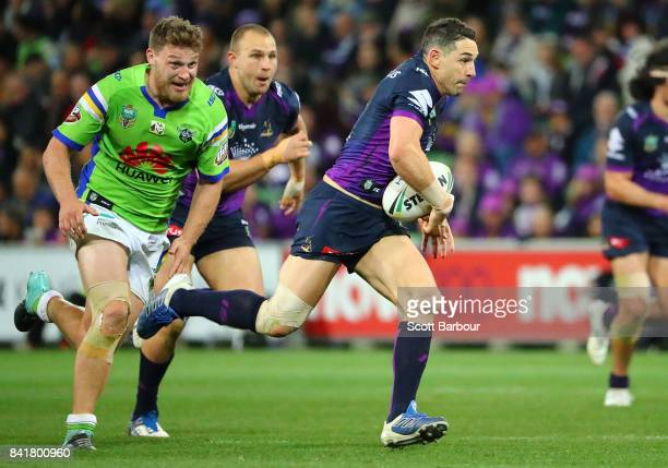 Billy Slater of the Storm runs with the ball during the round 26 NRL match between the Melbourne Storm and the Canberra Raiders at AAMI Park on...