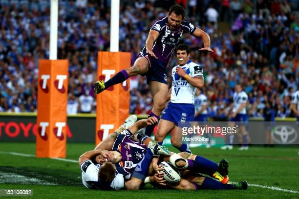 Billy Slater of the Storm scores a try during the 2012 NRL Grand Final match between the Melbourne Storm and the Canterbury Bulldogs at ANZ Stadium...