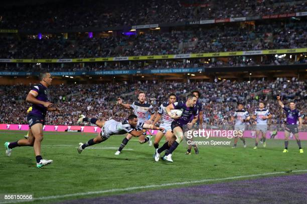 Billy Slater of the Storm scores a try during the 2017 NRL Grand Final match between the Melbourne Storm and the North Queensland Cowboys at ANZ...