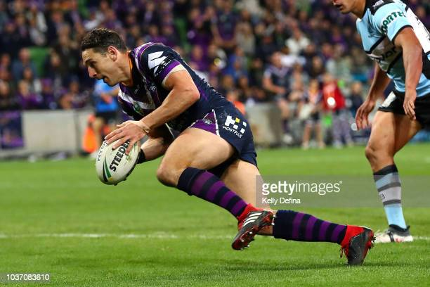 Billy Slater of the Storm scores a try during the NRL Preliminary Final match between the Melbourne Storm and the Cronulla Sharks at AAMI Park on...