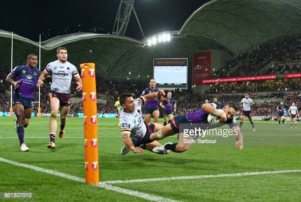 Billy Slater of the Storm scores a try during the NRL Preliminary Final match between the Melbourne Storm and the Brisbane Broncos at AAMI Park on...