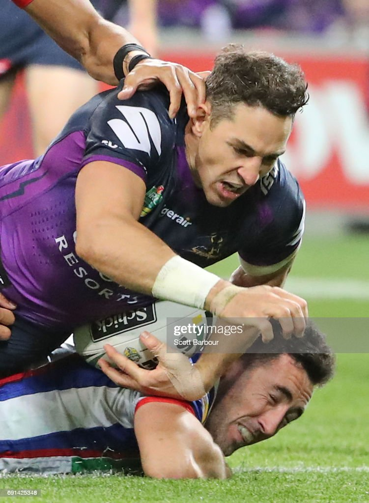Billy Slater of the Storm scores a try during the round 13 NRL match between the Melbourne Storm and the Newcastle Knights at AAMI Park on June 2, 2017 in Melbourne, Australia.