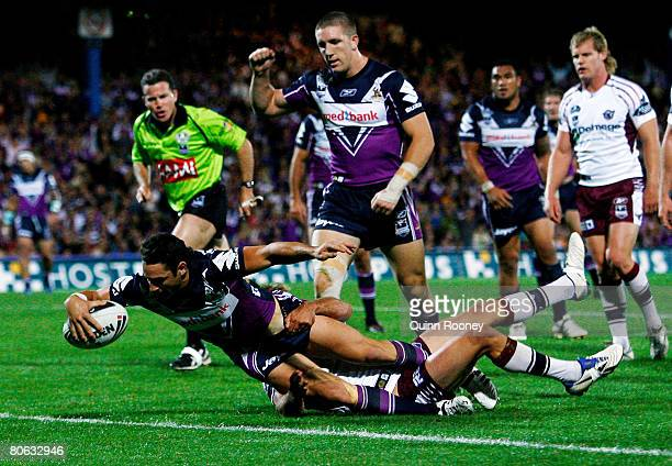 Billy Slater of the Storm scores a try during the round five NRL match between the Melbourne Storm and the Manly Warringah Sea Eagles at Olympic Park...