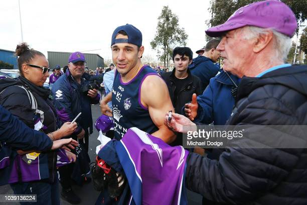 Billy Slater of the Storm signs autographs for fans after a Melbourne Storm NRL training session at Gosch's Paddock on September 24 2018 in Melbourne...