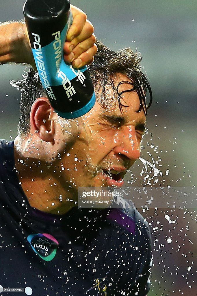 Billy Slater of the Storm sprays himself with water during the round one NRL match between the Melbourne Storm and the St George Illawarra Dragons at AAMI Park on March 7, 2016 in Melbourne, Australia.