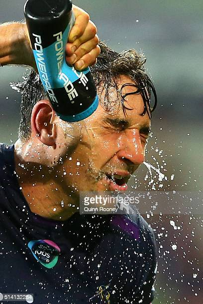 Billy Slater of the Storm sprays himself with water during the round one NRL match between the Melbourne Storm and the St George Illawarra Dragons at...
