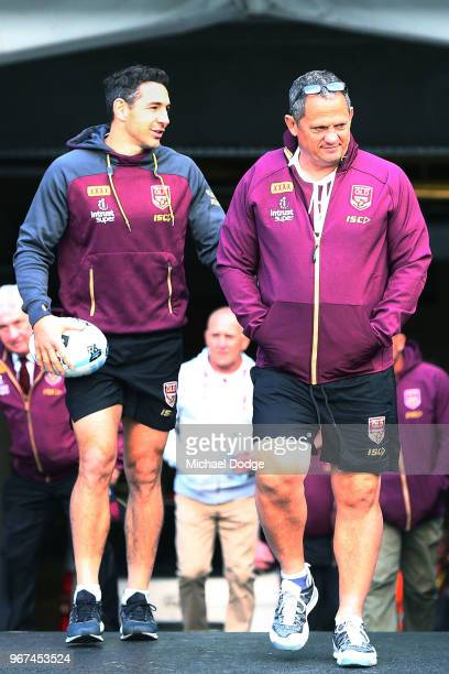Billy Slater out with a hamstring injury walks out on the field with coach Kevin Walters during a Queensland Maroons Captain's Run at the Melbourne...