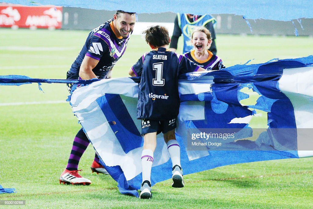 Billy Slater runs out through the banner with hisÊÊtwo children, daughter Tyla Rose and son Jake, for this 300th match during the round two NRL match between the Melbourne Storm and the Wests Tigers at AAMI Park on March 17, 2018 in Melbourne, Australia.