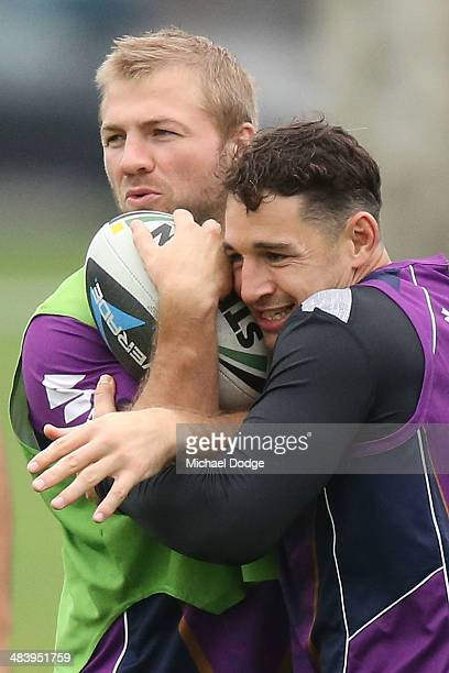 Billy Slater tackles Ryan Hinchcliffe during a Melbourne Storm NRL training session at Gosch's Paddock on April 11 2014 in Melbourne Australia