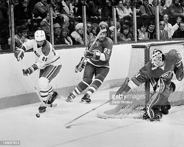 Billy Smith of the New York Islanders attempts to poke check the puck off the stick of Randy Bucyk of the Montreal Canadiens Circa 1985 at the...