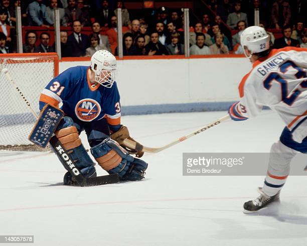 Billy Smith of the New York Islanders makes a glove save on a shot by Bob Gainey of the Montreal Canadiens Circa 1980 at the Montreal Forum in...