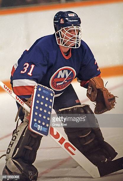 Billy Smith of the New York Islanders prepares for a shot against the Toronto Maple Leafs during game action on November 6 1985 at Maple Leaf Gardens...