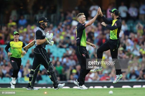 Billy Stanlake of Australia celebrates with Glenn Maxwell of Australia after taking the wicket of Martin Guptill of New Zealand during game one of...