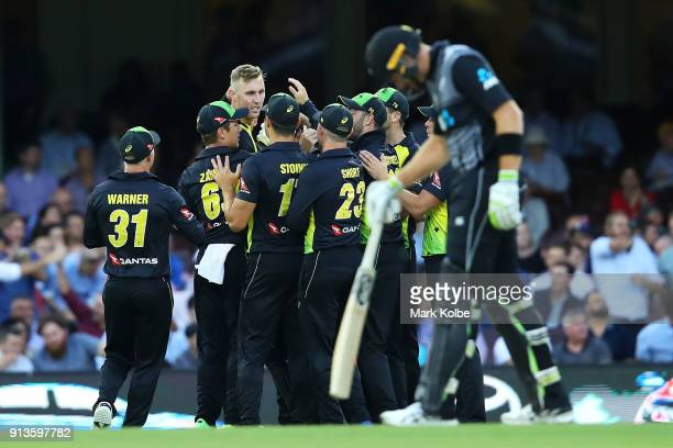 Billy Stanlake of Australia celebrates with his team after taking the wicket of Colin Munro of New Zealand during game one of the International...