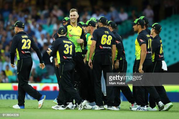 Billy Stanlake of Australia celebrates with his team after taking the wicket of Tom Bruce of New Zealand during game one of the International...