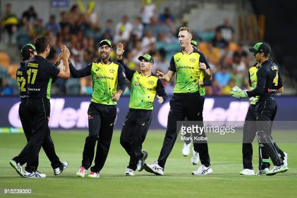 Billy Stanlake of Australia celebrates with his team after taking the wicket of Adil Rashid of England during the Twenty20 International match...