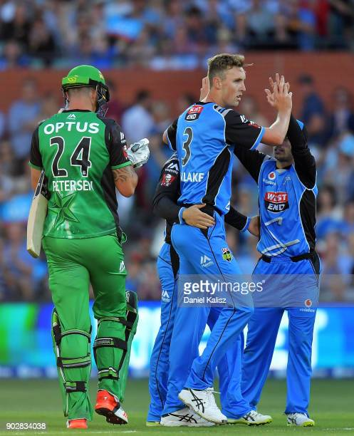 Billy Stanlake of the Adelaide Strikers celebrates with his team mates after bowling out Kevin Pietersen of the Melbourne Stars during the Big Bash...
