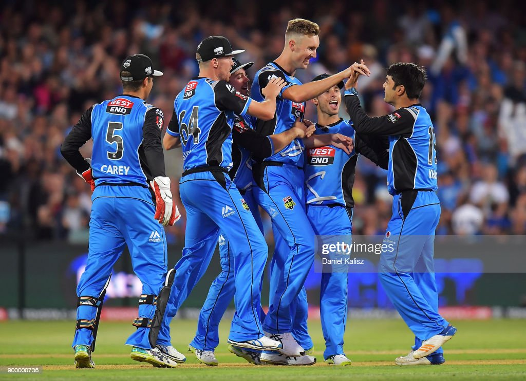 Billy Stanlake of the Adelaide Strikers celebrates with Rashid Khan of the Adelaide Strikers after taking the wicket of Joe Burns of the Brisbane Heat during the Big Bash League match between the Adelaide Strikers and the Brisbane Heat at Adelaide Oval on December 31, 2017 in Adelaide, Australia.