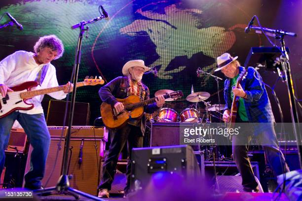 Billy Talbot of Crazy Horse, Willie Nelson and Neil Young perform on stage during the Farm Aid Concert at Hersheypark Stadium on September 22, 2012...