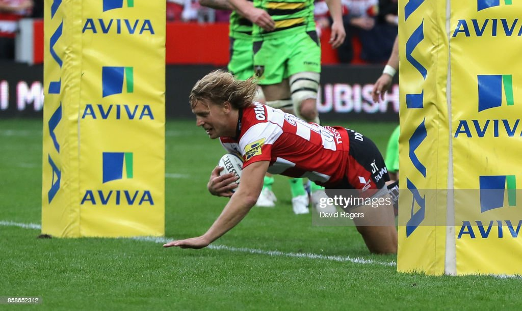 Billy Twelvetrees of Gloucester dives to score their fourth try during the Aviva Premiership match between Gloucester Rugby and Northampton Saints at Kingsholm Stadium on October 7, 2017 in Gloucester, England.