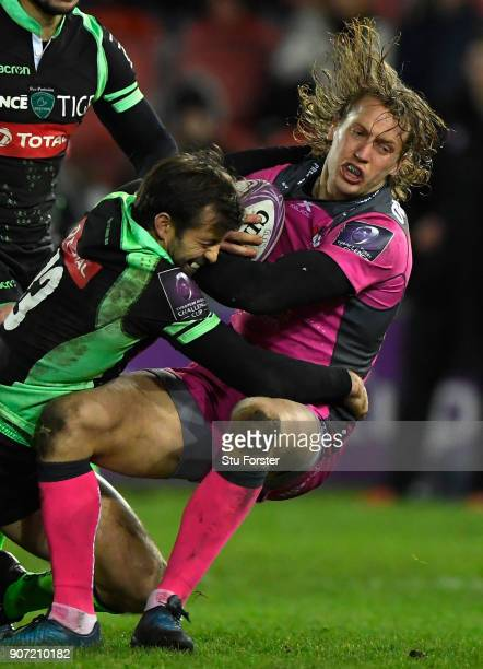 Billy Twelvetrees of Gloucester is hit hard by Conrad Smith of Paloise during the European Rugby Challenge Cup match between Gloucester and Section...